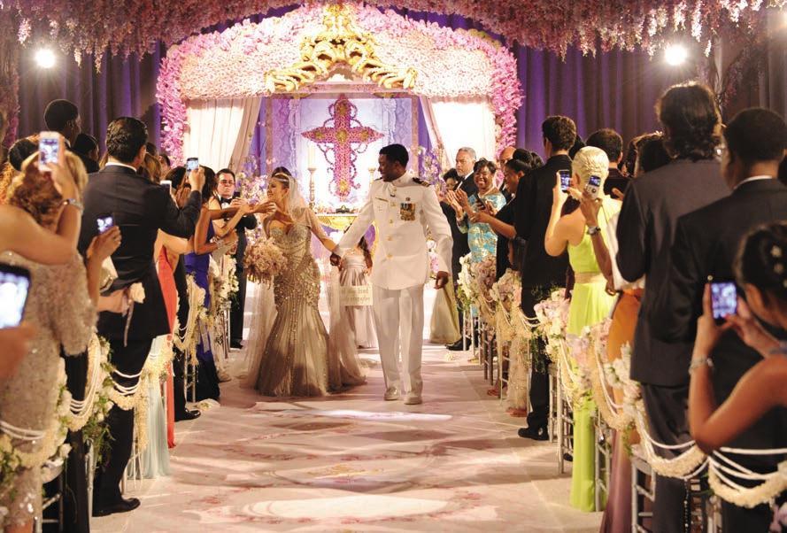 The Bride and Groom walk down the isle