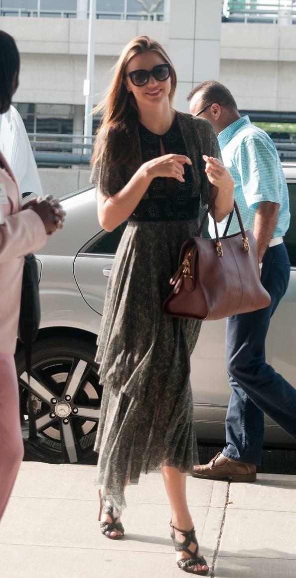 Miranda Kerr carrying Tod's Sella Bag at JFK New York July14-2013