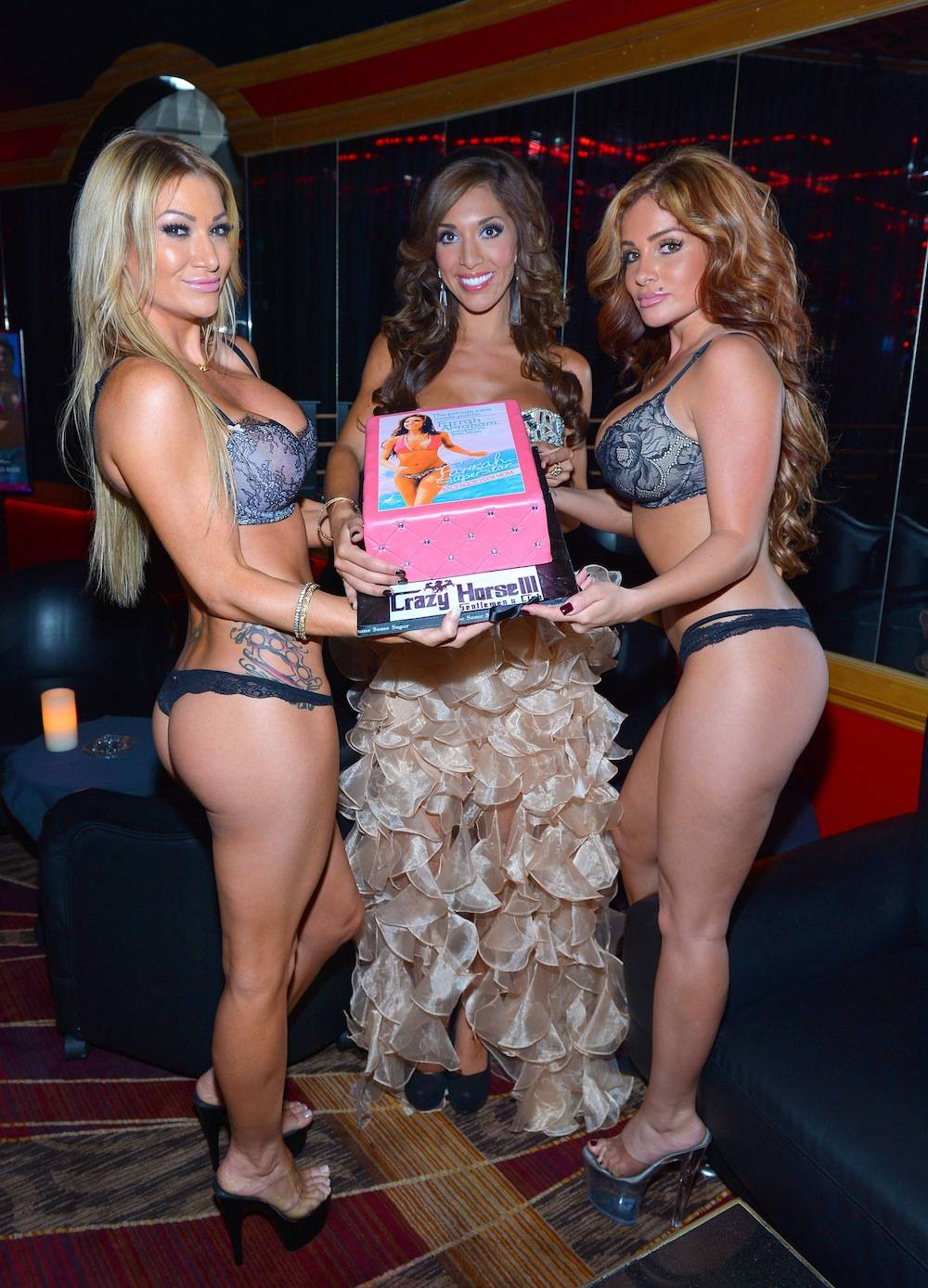 Crazy Horse III entertainers presenting cake to Farrah Abraham
