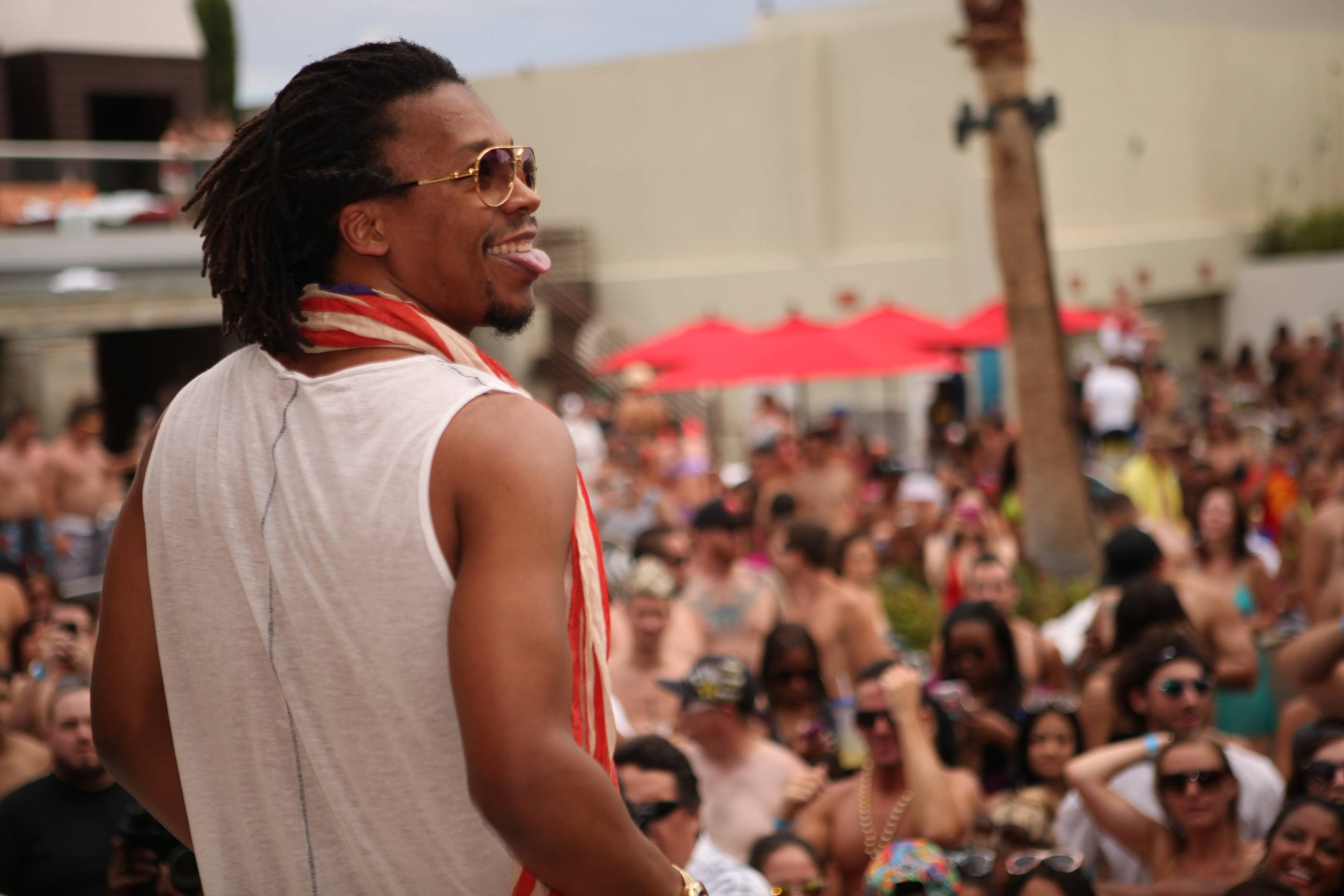 Lupe Fiasco smiles at crowd