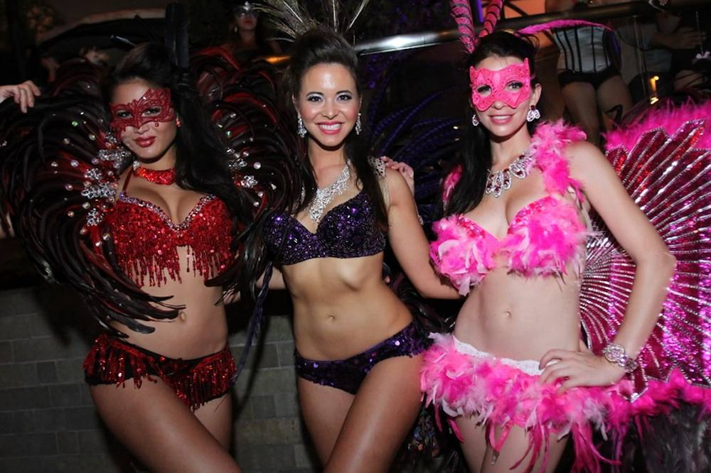 Partygoers show off costumes