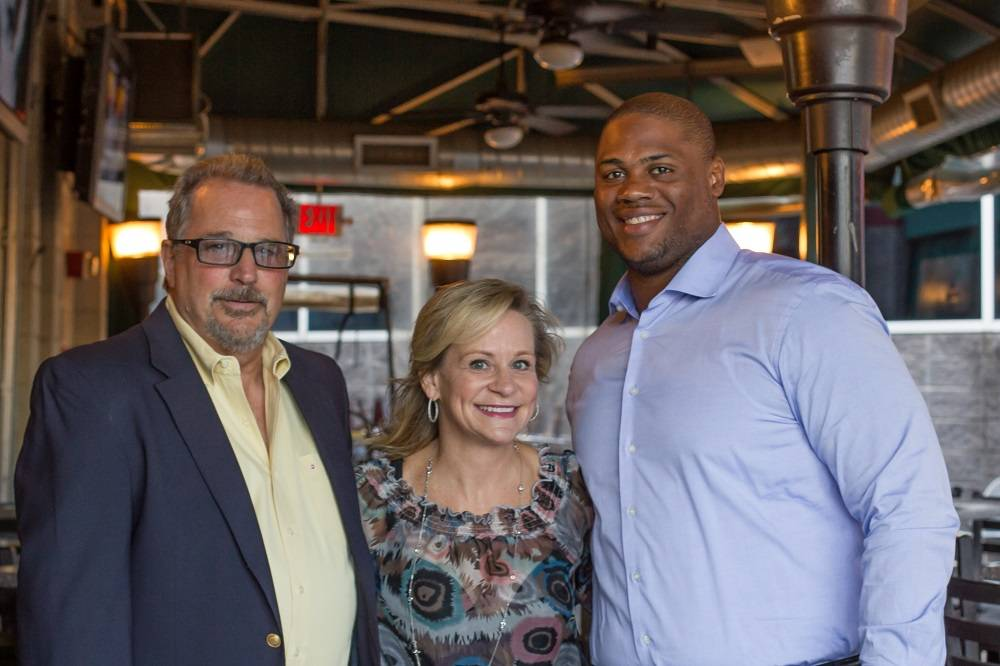 Dantanna's co-owner Jay Kazlow, Rally Foundation president Dean Crowe and Atlanta Falcon Corey Peters