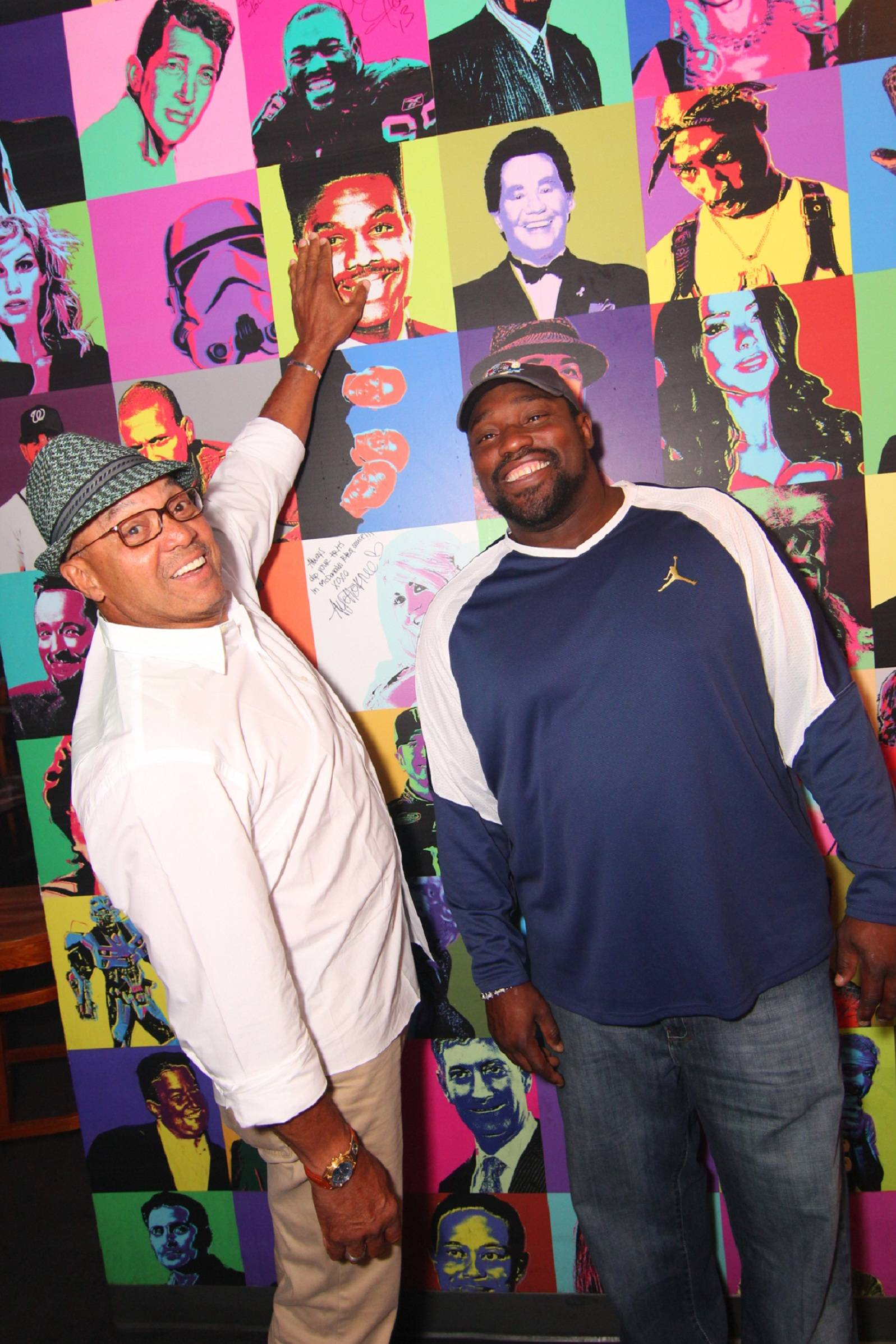 Reggie Jackson and Warren Sapp Sign Celebrity Wall at Rockhouse