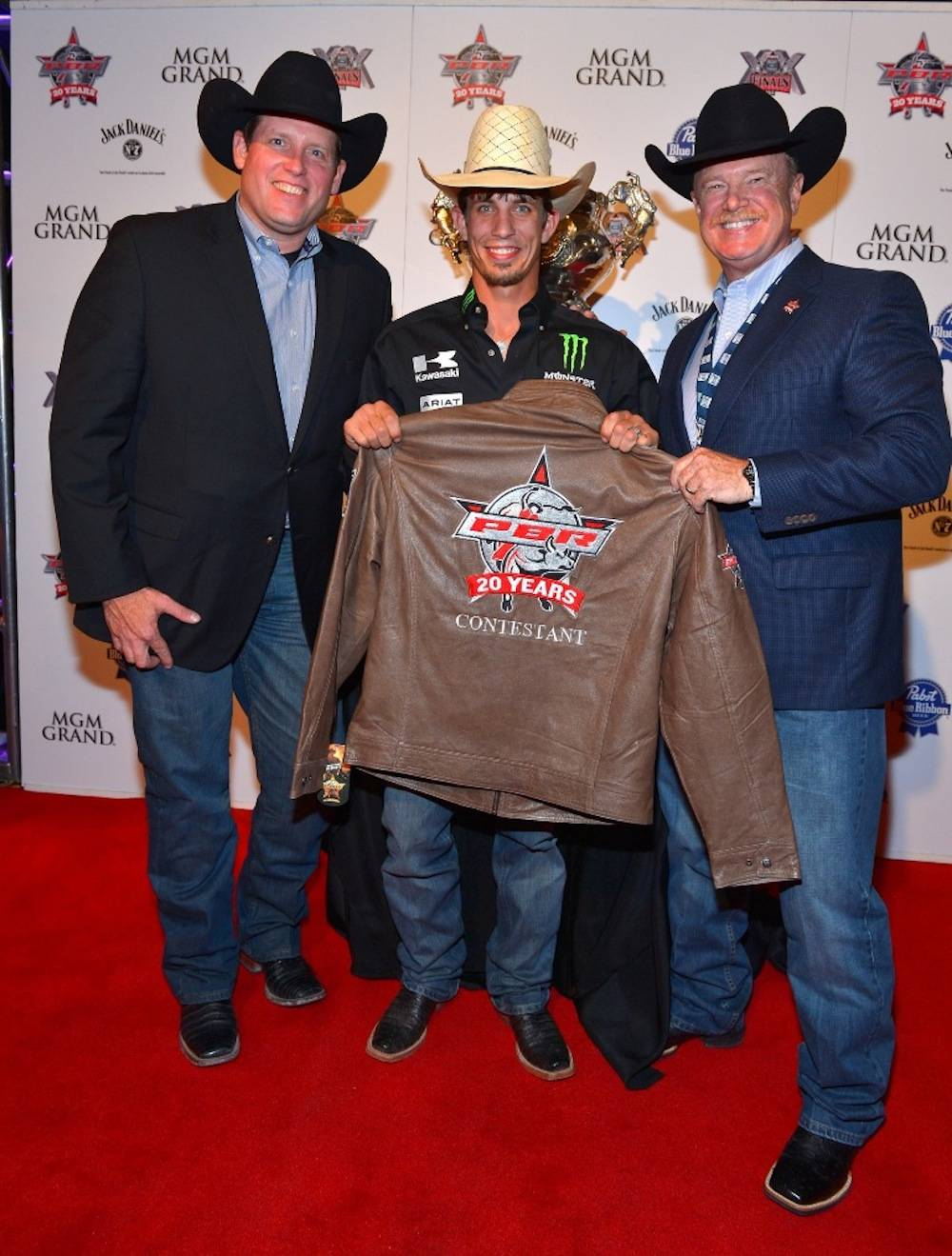 10.21.13 Bull rider JB Mauney with Sean Gleason (left) and Jim Haworth (right) at the Welcome Reception at MGM Grand. Photo by Bryan Steffy