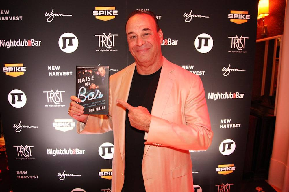 "Jon Taffer with his newest book ""Raise the Bar – An Action-Based Method for Maximum Customer Reactions"""