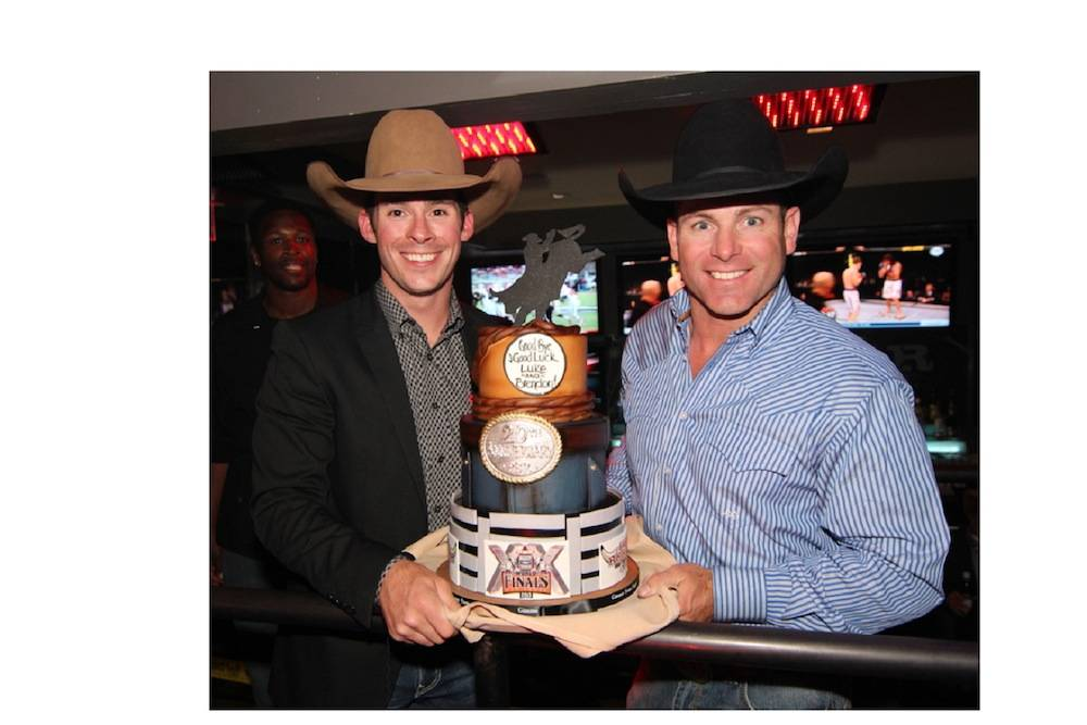 Brendon Clark and Luke Snyder Proudly Display Retirement Cake at PBR Rock Bar