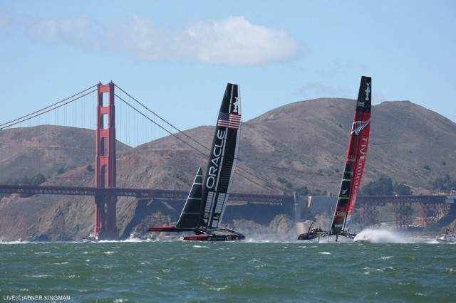 Oracle Team USA overtaking Team New Zealand by the Golden  Gate Bridge at the final match.