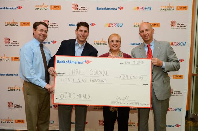 From left: Matt Muldoon (Chief Development Officer, Three Square Food Bank), Lou Garate (Senior Director, NASCAR), Lidia Bastianich and Steve McCracken (Senior Vice President, Bank of America) pose with the Bank of America Charitable Trust's $29,000 donation to Three Square.