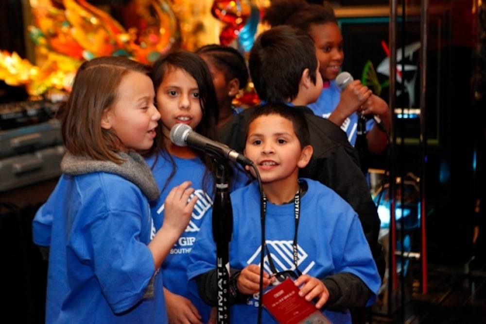 Kids from Boys & Girls Clubs of Southern Nevada sing Christmas songs to attendees at Miracle Mile Shops' Rockin Holidays_Low Res