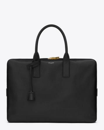 Signature Saint Laurent large briefcase with tubular handles, padlock with leather encased keys and embossed Saint Laurent Signature. 100% Leather grosgrain lining Double zip closure Interior zip pocket and iPad compartment