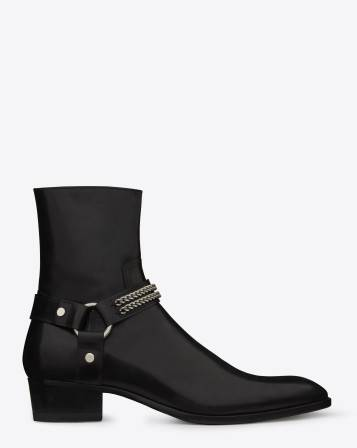 Classic Saint Laurent Ankle Boot with Perforated Detailing, Elastic Side Panels and Pull Tab.  100% Leather Made In Italy
