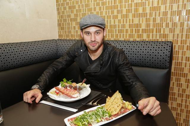 Ryan Guzman dines on a shellfish platter and New York sirloin carpaccio at N9NE Steakhouse. Photos: Edison Graff