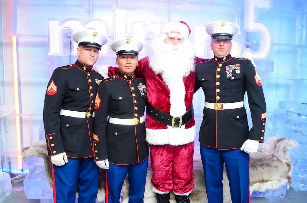 US Marines Cpl Baker, Sgt Yommalat, and Sgt Ringgold accompanied by Santa at Minus5Ice Bar - credit Julio Castillo