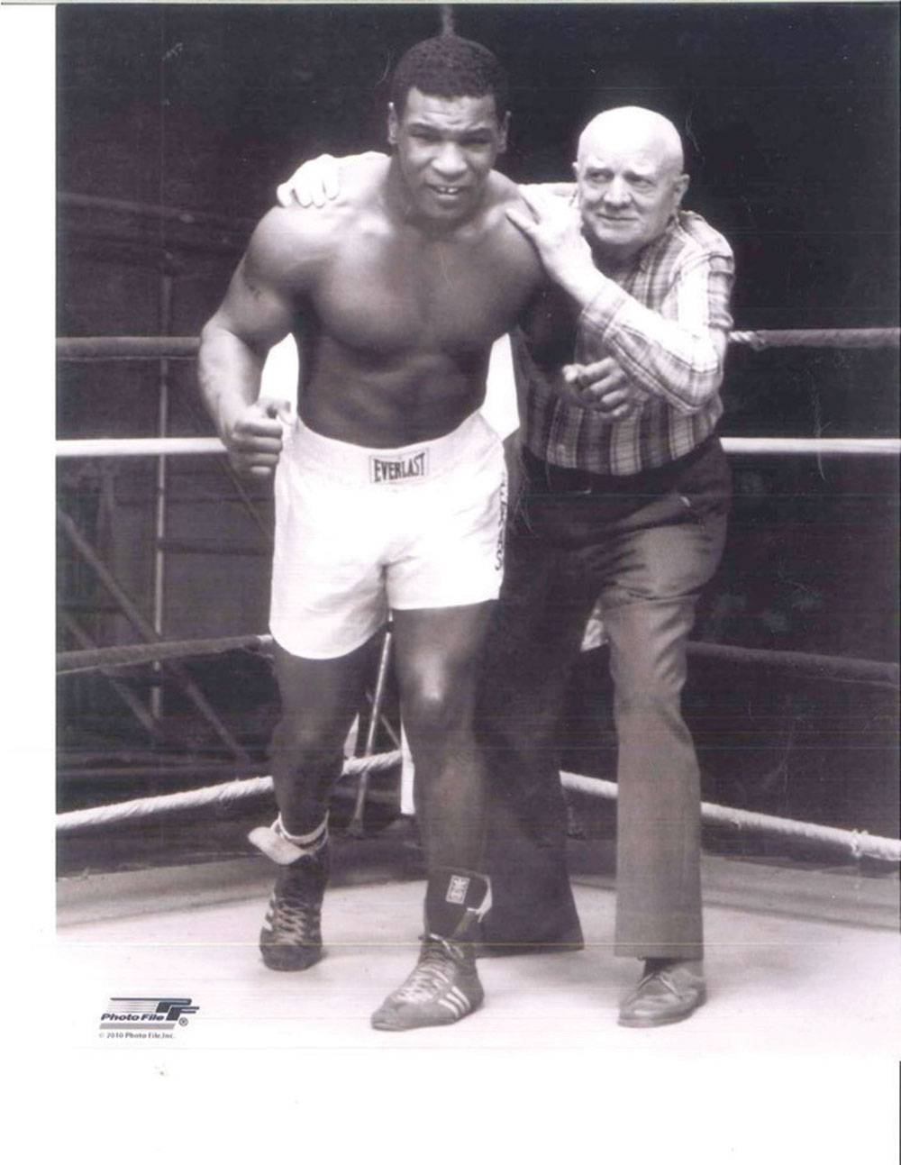 Tyson (age 17) with his boxing trainer and mentor, Cus D'Amato