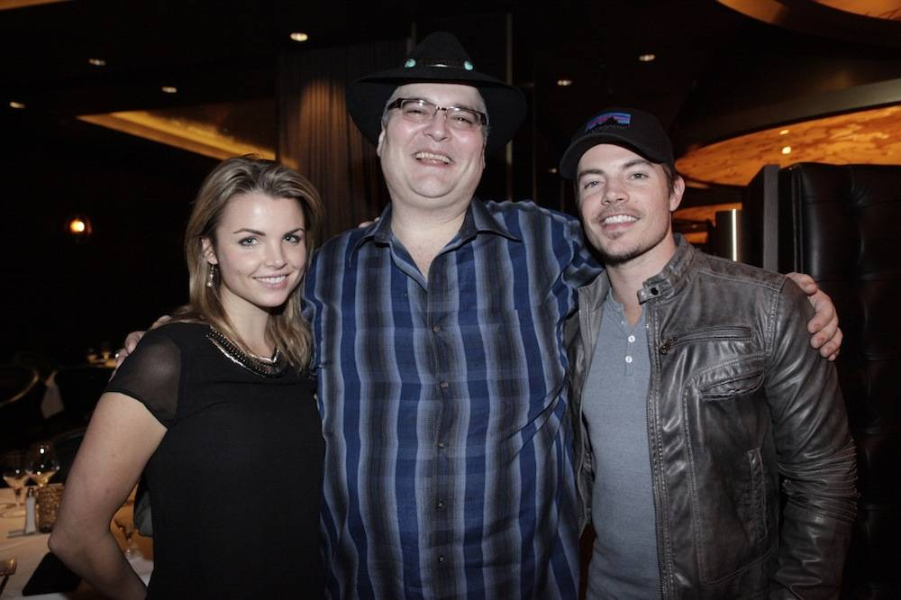 Andrea Boehlke and Josh Henderson pose with John Popper at Andiamo Steakhouse at the D Las Vegas 1.2.14