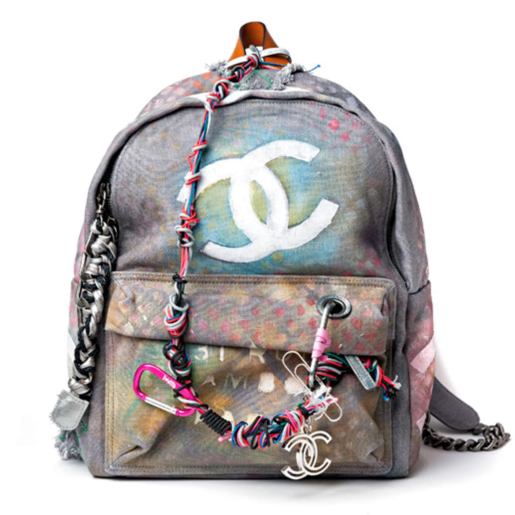 2dd4a7b8f309 Backpacks aren't just for carrying textbooks anymore! Chanel debuted its  latest graffiti-inspired backpack on the Spring 2014 runway back in  September, ...