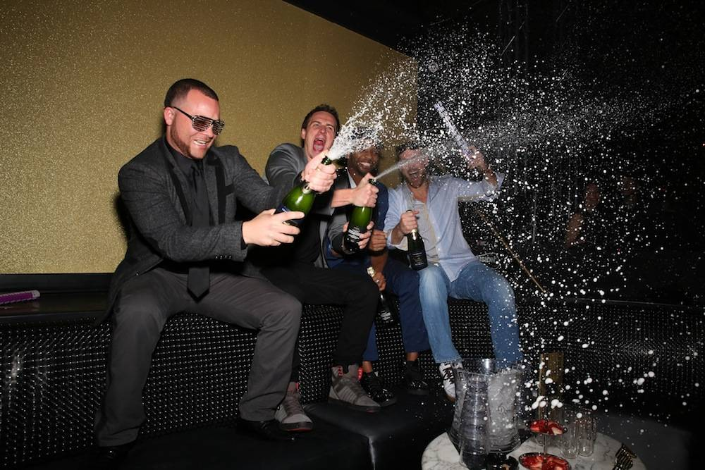 Lochte and Friends Pops Bottles to Celebrate 2014 at SHe by Morton's in Las Vegas