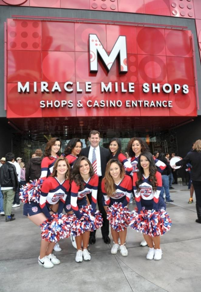 Miracle Mile Shops General Manager Jerry Irwin and USA Eagles Cheerleaders