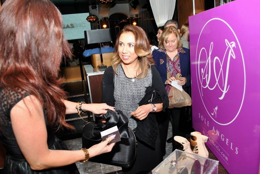 02.04.14 Guest donates shoes to Sole Angels during VEGAS INC's Women to Watch event at Hyde Bellagio_photo credit Jessie Ayala