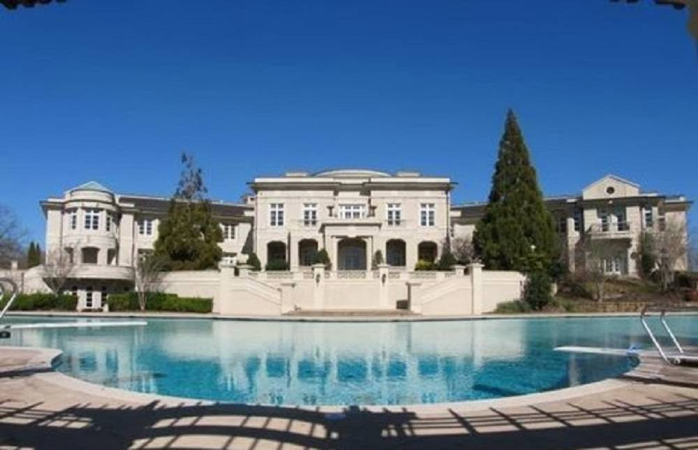 Rick Ross Buys Evander Holyfield Estate With Charitable ...