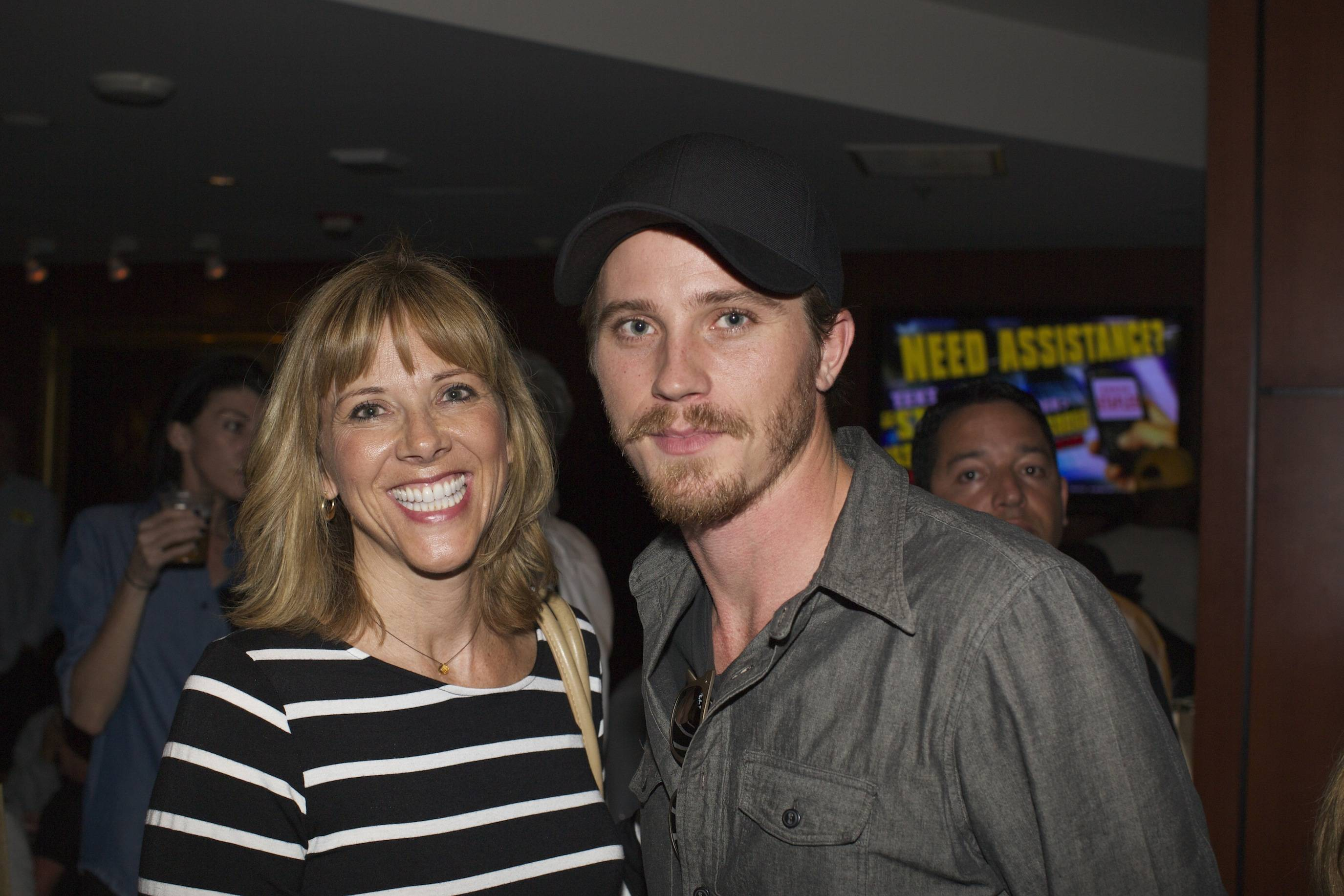 Garrett Hedlund and his mother at the Versace Shopping Event benefiting the Lakers Youth Foundation & STAPLES Center Foundation