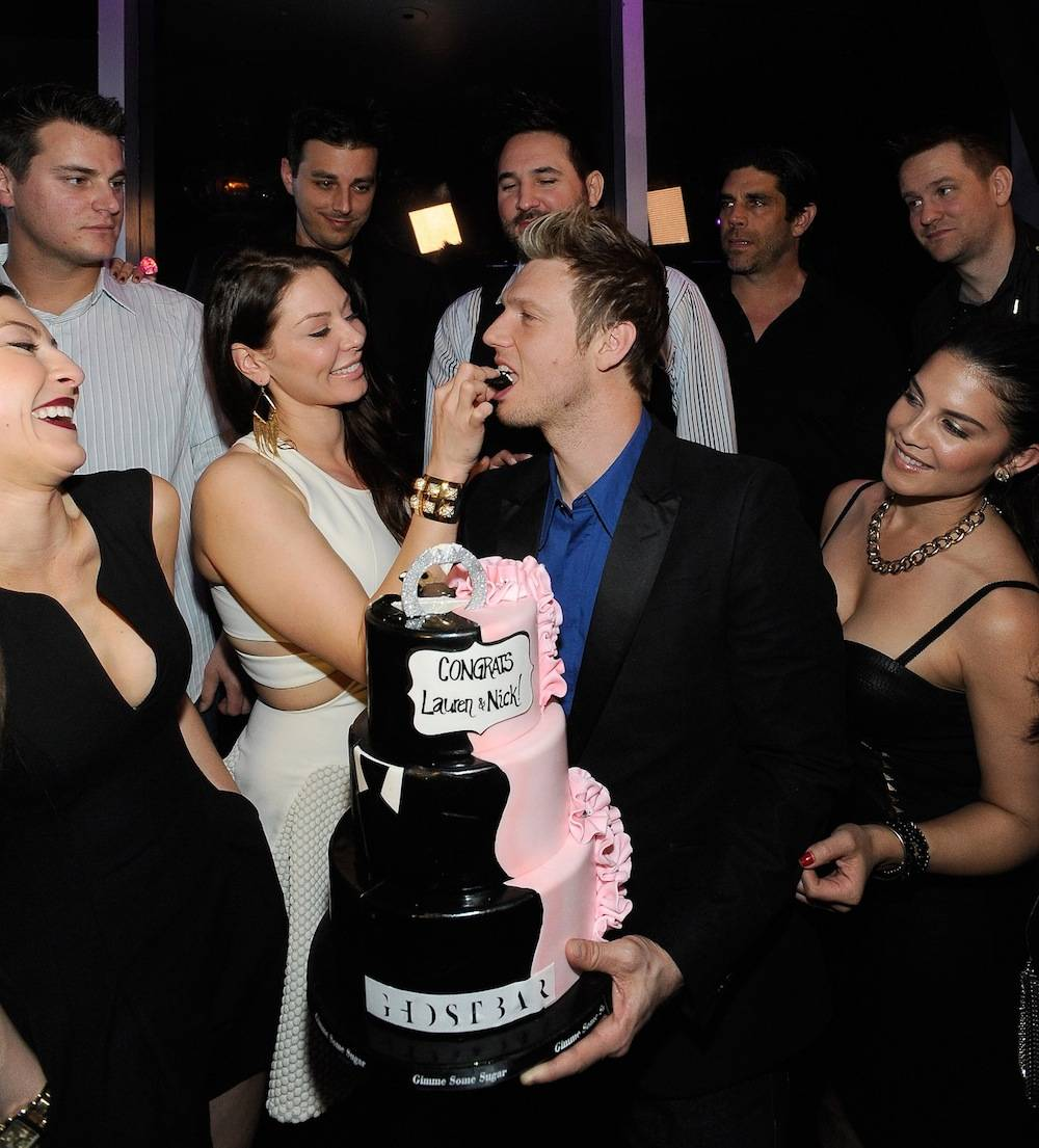 Lauren Kitt feeds Nick Carter cake-topper diamond ring inside Ghostbar during coed bachelor and bachelorette party. Photo: David Becker/WireImage