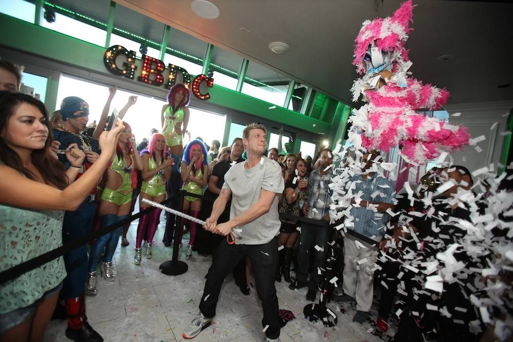 Nick Carter hitting pinata at Ghostbar Dayclub (Joe Fury)