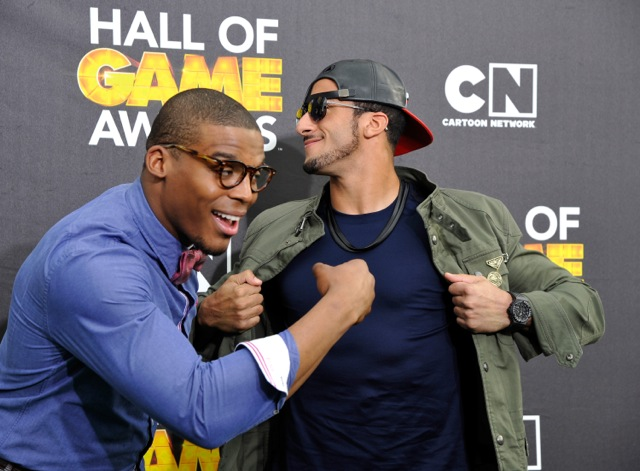 Cam Newton and Colin Kaepernick on red carpet imitating signature moves  Credit:  Getty courtesy of Cartoon Network