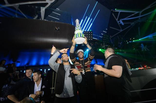 Sidney Rice holds up a cake at Hakkasan. Photos: Al Powers/Powers Imagery