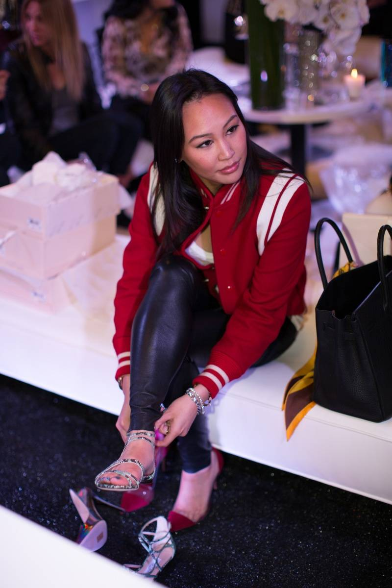 Dorothy Wang trying on shoes at the Lakers and Jimmy Choo Shopping Event benefitting Lakers Youth Foundation