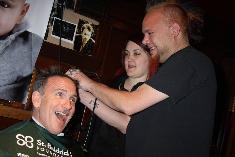 Food critic Al Manchini shaves Chef Rick Moonen's hair at Ri Ra Las Vegas' St. Baldrick's fundraiser March 1, 2014_low