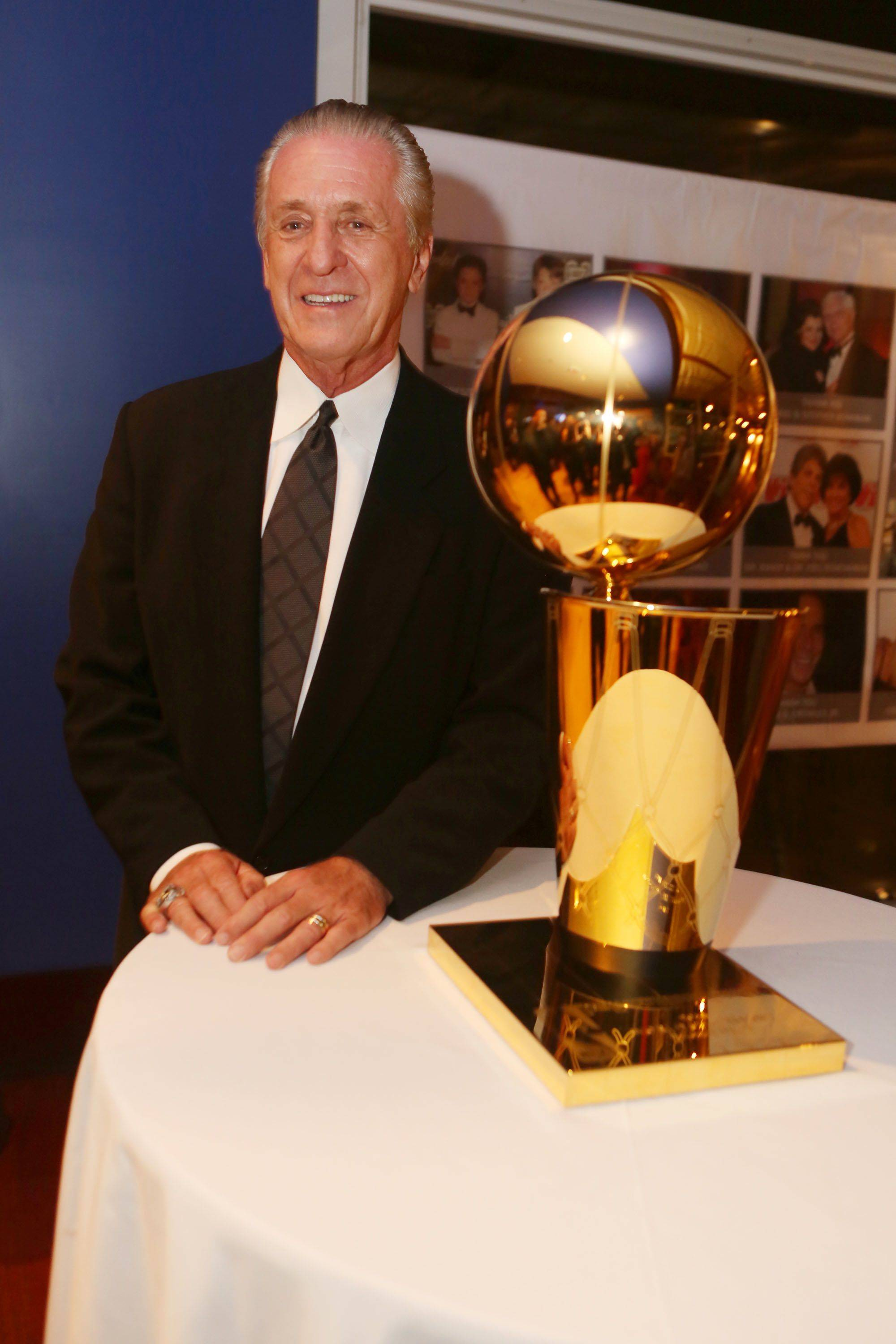 Pat Riley With HEAT Championship Trophy