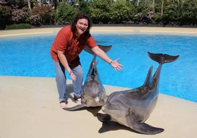 Dot Marie Jones with Dolphins Lightning and Osborne at Siegfried & Roy's Secret Garden and Dolphin Habitat at The Mirage - 3.31.14