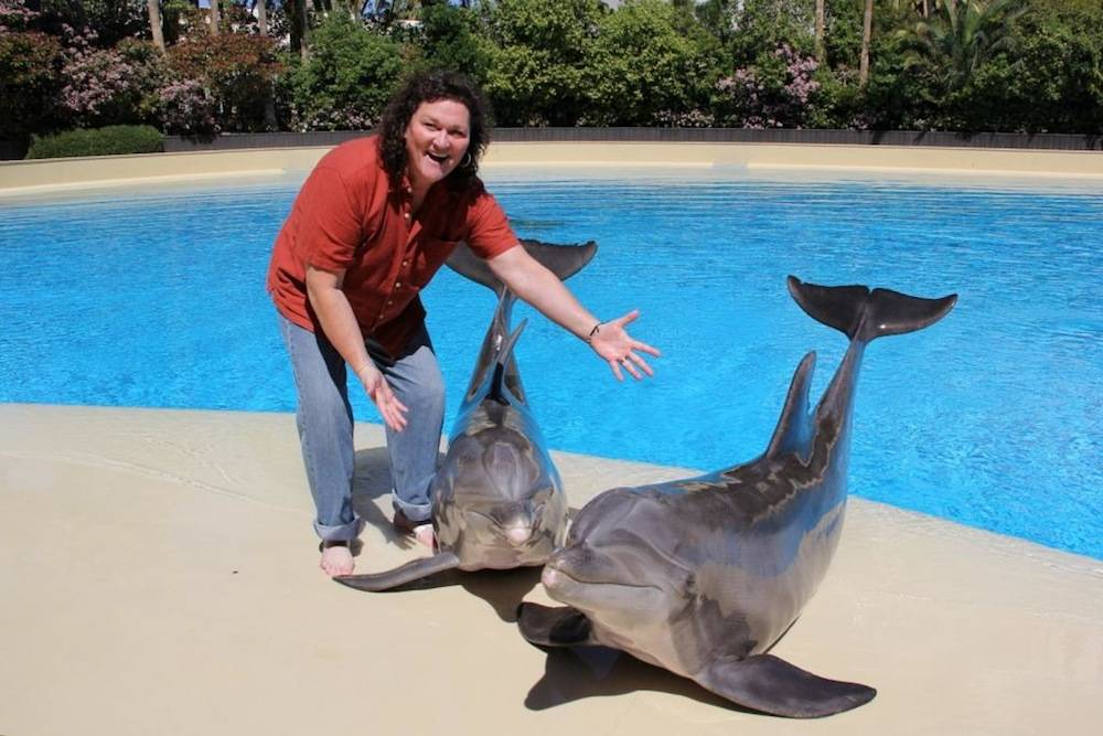Dot Marie Jones with Dolphins Lightning and Osborne at Siegfried & Roy's Secret Garden and Dolphin Habitat at The Mirage – 3.31.14