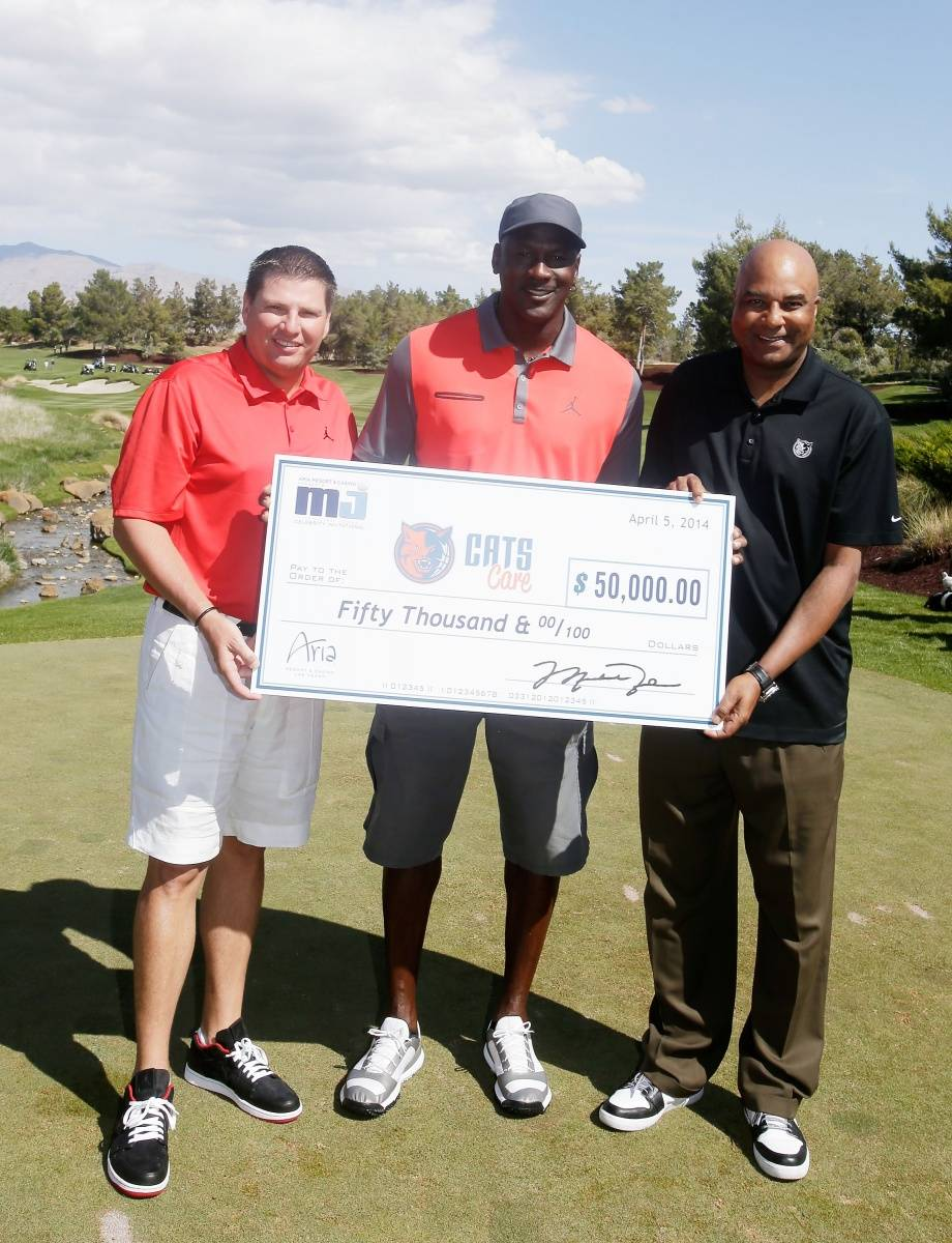 Executive Vice President MGM Resorts International Tyler Shook (L) and NBA legend Michael Jordan and Bobcat's Sports and Entertainment President & Coo Fred Whitfield