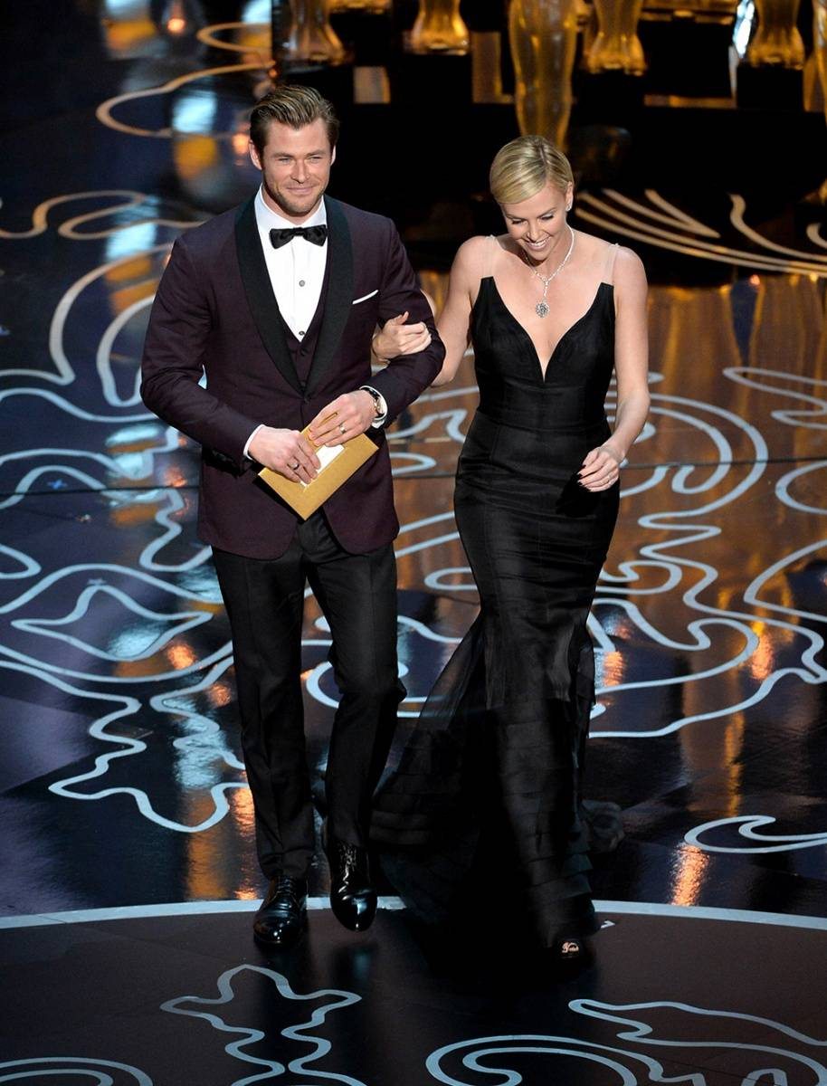 For Chris Hemsworth, David designed a deep black cherry dinner jacket with a black satin shawl lapel and satin trim worn over a white diamond bib tuxedo shirt and paired with a solid black tuxedo pant.