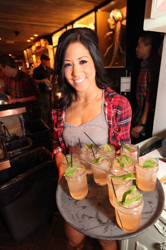 Server with signature cocktails
