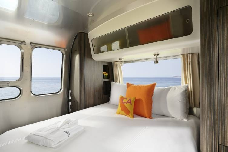 AKA Mobile Suite Interior Bedroom Featuring AKA Luxury Amenities Like AKA's Plush Linens, Bathrobe, and Trina Turk California Pillow