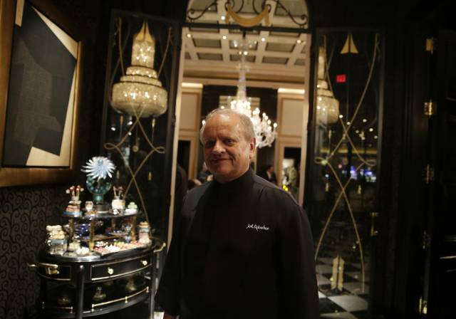 Chef Joel Robuchon greets guest before When in France dinner (credit Isaac Brekken for Bon Appetit)