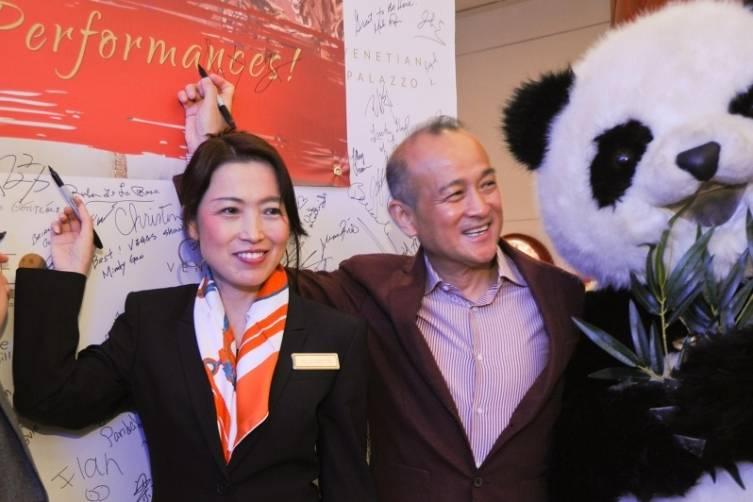 Elizabeth Hansen, Venetian Palazzo Director of Asian Leisure Marketing and PANDA! Director An Zhao Sign to Commemorate 100th PANDA! Show_Credit_Joseph Donato_Cashman Photo