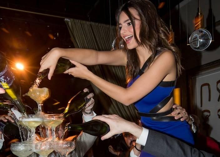 Emily Ratajkowski pours champagne over 385-glass tower during Condé Nast Traveler's 2014 Hot List Party_kabik-327