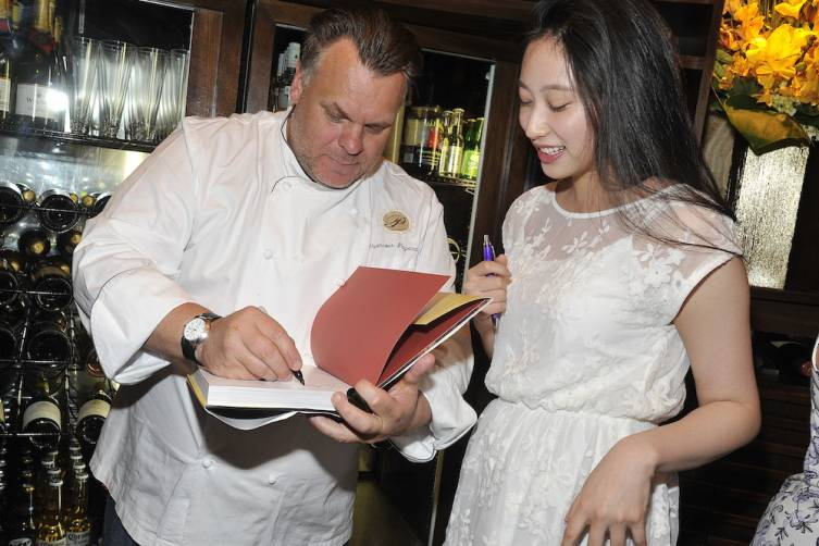 Francois Payard mingles with guests at Pastry Savvy (credit Isaac Brekken for Bon Appetit)