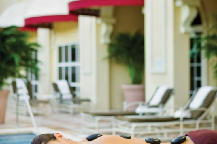 Hot Stones on Acqualina Spa By ESPA pool deck