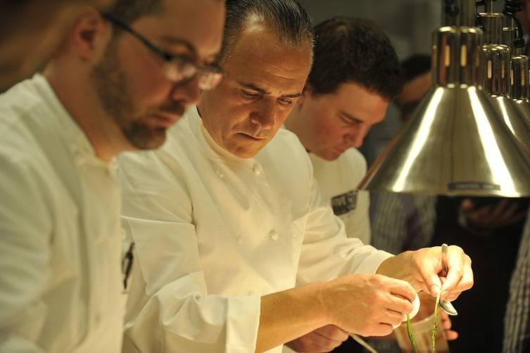 Jean-Georges Vongerichten preparing plates at Celebrity Chef Brunch (credit Isaac Brekken for Bon Appetit)