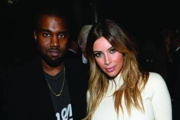 Kanye West + Kim Kardashian, credit Getty Images