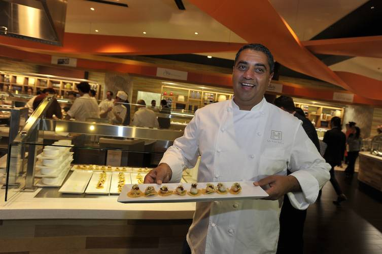 Michael Mina presents a dish at All-Star Feast (credit Isaac Brekken for Bon Appetit)