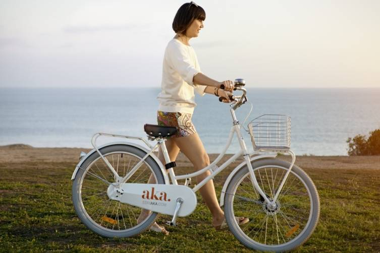 Trina Turk in Delano Short and Solvang Top with AKA's Sleek Custom Bicycles That Are Complimentary to AKA Residents