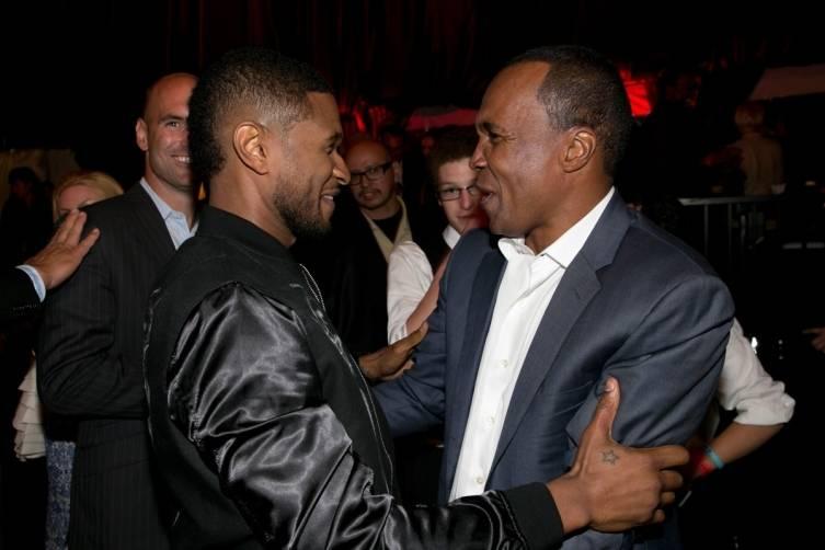 Usher greets Sugar Ray Leonard at SRL Foundation Charity Boxing Night - Getty