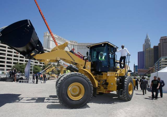 WBC welterweight champion Floyd Mayeather Jr. arrives on a bull dozer during a groundbreaking for a $375 million, 20,000-seat sports and entertainment arena being built by MGM Resorts International and AEG. The arena is scheduled to open in early 2016. Photos: Isaac Brekken/Getty Images