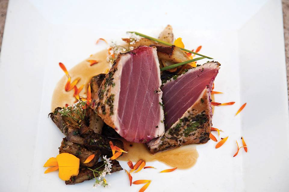 AQ---herb-seared-yellowfin-tuna-served-over-wild-mushroom-capers-and-salsify---photo-credit-Simon-Hare